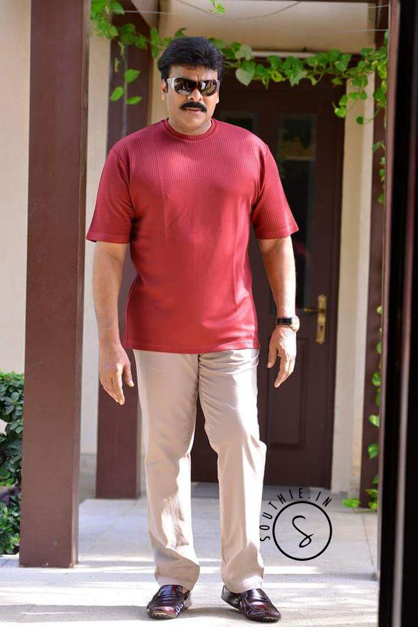 Another Picture of Megastar Chiranjeevi in a red Tee and khaki pants. Megastar Chiranjeevi latest photoshoot 2015 Birthday Special.