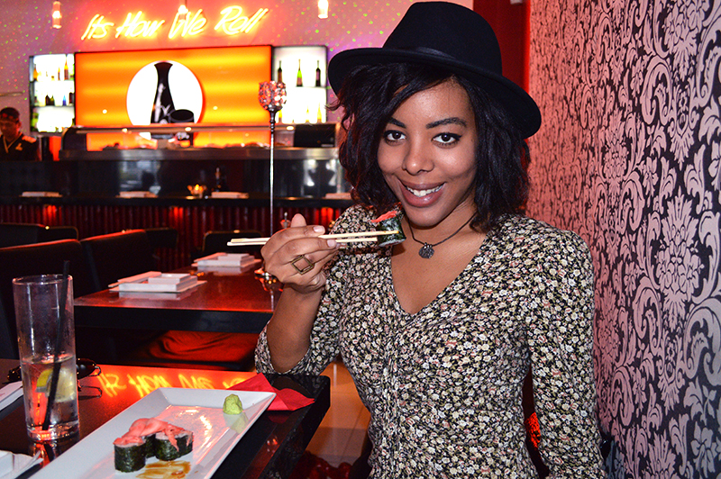 Fashion Blogger Anais Alexandre of Down to Stars wearing a Target fedora with a vintage dress eating sushi at Sushi Sake