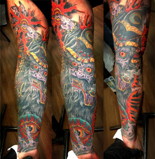 Sleeve tattoo of a wizard with all seeing eye in an orb by tattoo artist Jason Kunz for Triumph Tattoo