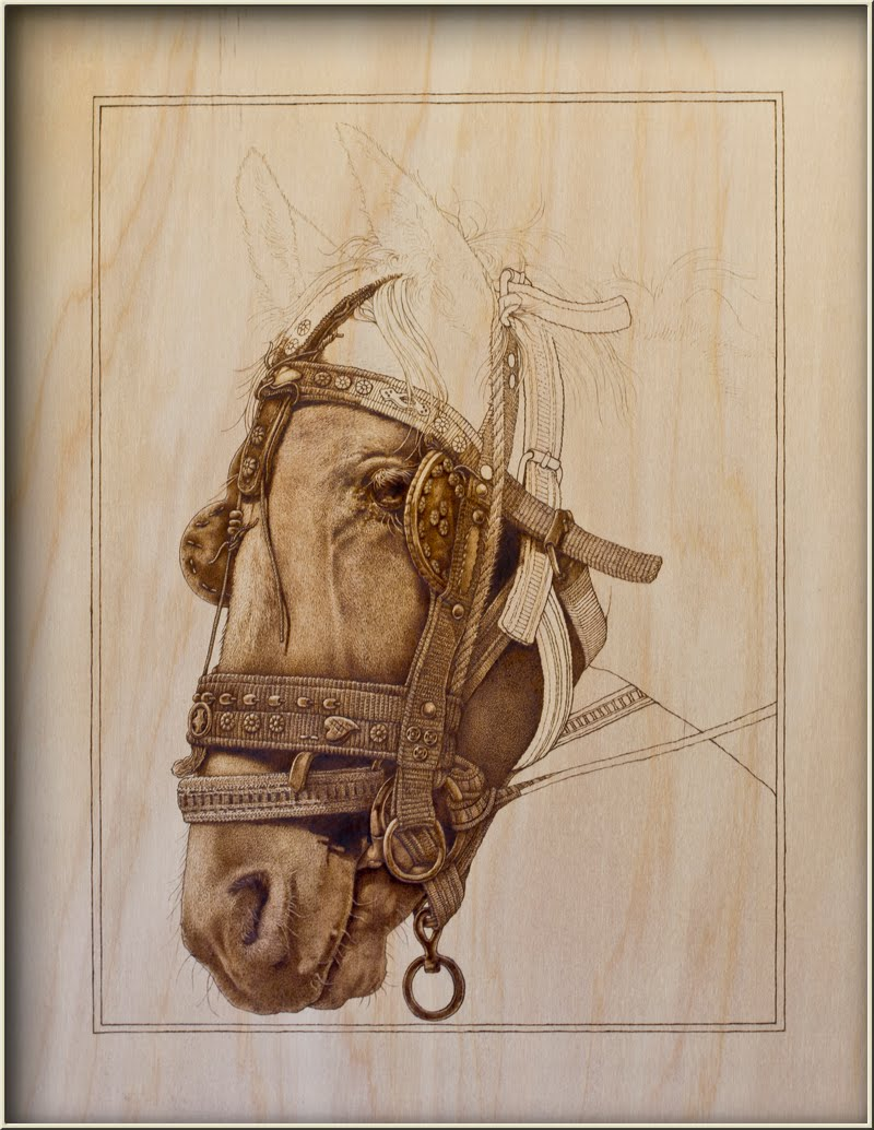 Whimsical wood horse pyrography underway a small high