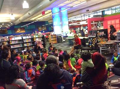 A librarian reads to children.