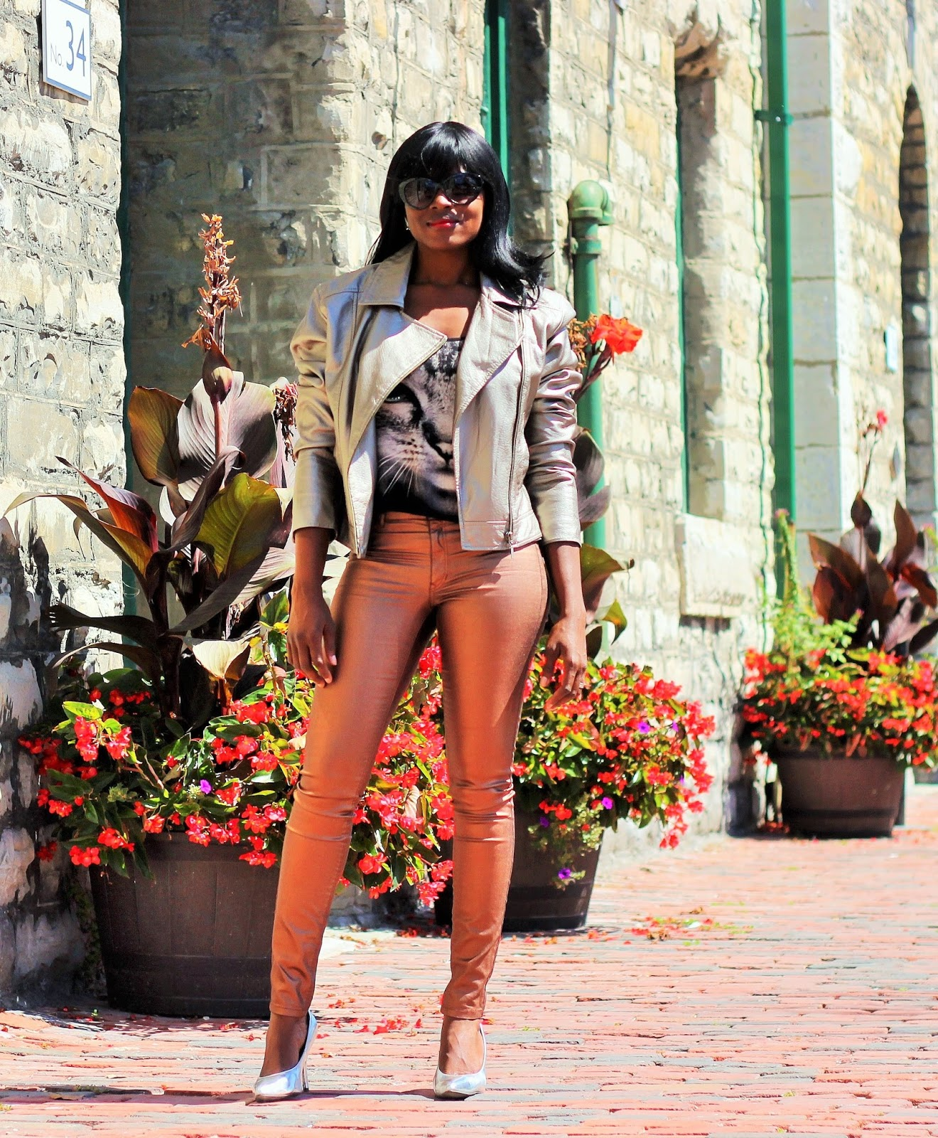 Metallic Gold Jacket Styled With Metallic Gold Pants & Graphic Top