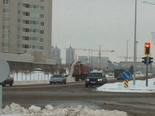 Clearing snow from roads in Astana