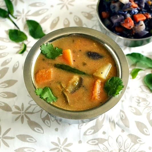 Erra Gummadikaya Pulusu (Andhra style Pumpkin Stew)