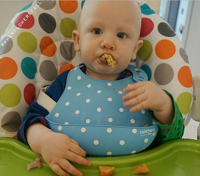 Baby Scout Wearing a Bubble Blue Catcherz Bib