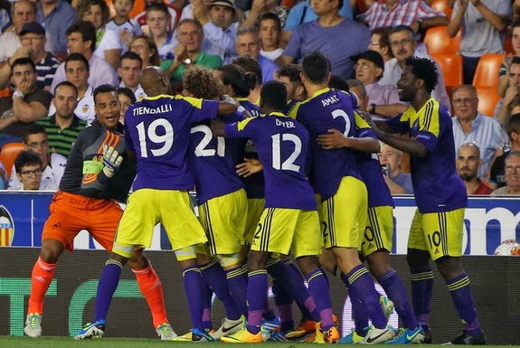 Swansea players celebrate their third goal against Valencia scored Jonathan de Guzmán