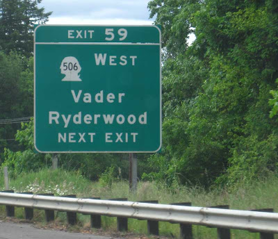 Green Washington State interstate sign for town of Vader, outline of Geo. Washington's head for route number