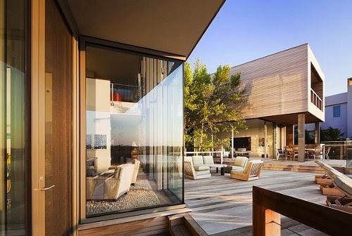 contemporary bay house with wide glass window