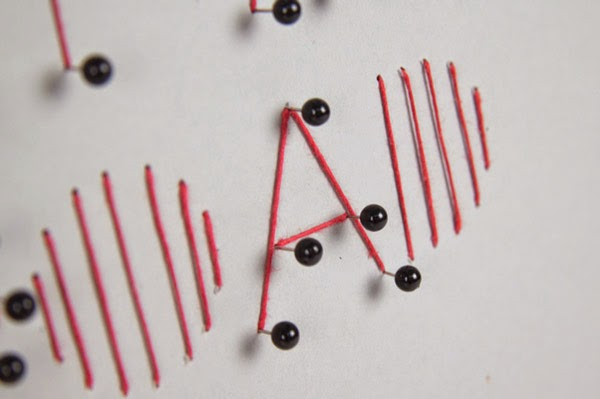 mina-bach-letters-made-with-string-and-pins