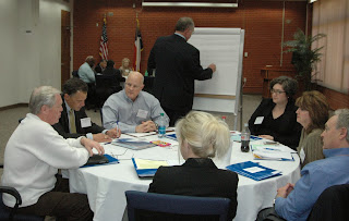 Parole board members work together on solutions.
