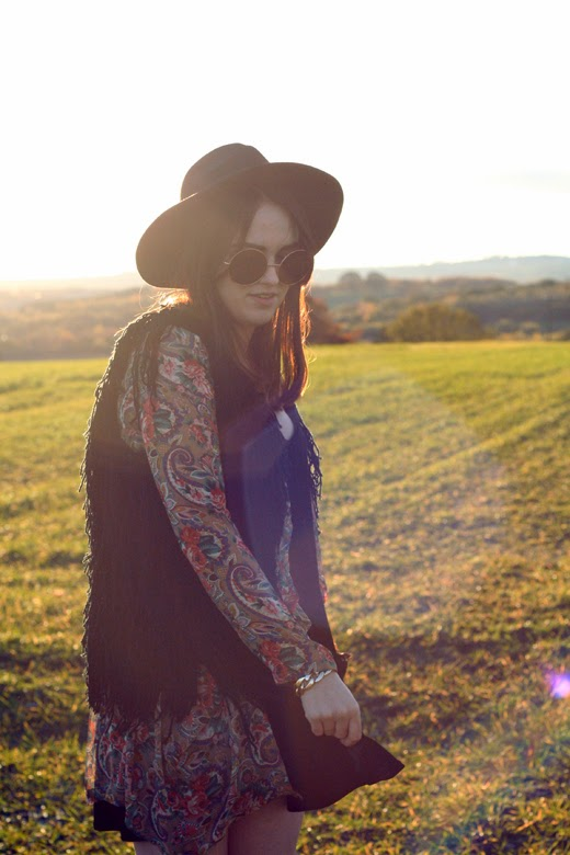 hippy, uk fashion blogger, uk fashion style, zerouv, oversized sunglasses, 70's sunglasses, knitted vest, tassel vest, tassel gilet, fedora, hippie, retro, retro pattern, autumn look, fall look, sunset photo, layering, autumn layering, missguided vellvet swing dress, oasap, cut out boots, office boots