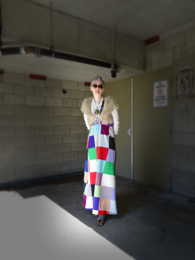 Bag and a Beret, Mel Kobayashi in patchwork skirt with uni-suspender