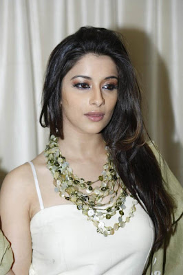 Gorgeous and ornamental madhurima in white dress looking hot and sexy