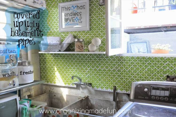 After: Laundry room walls covered with stenciled pegboard :: OrganizingMadeFun.com