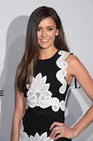 Nina Dobrev gorgeous in black and white dress at the Elle's 2016 Women In Television Dinner red carpet