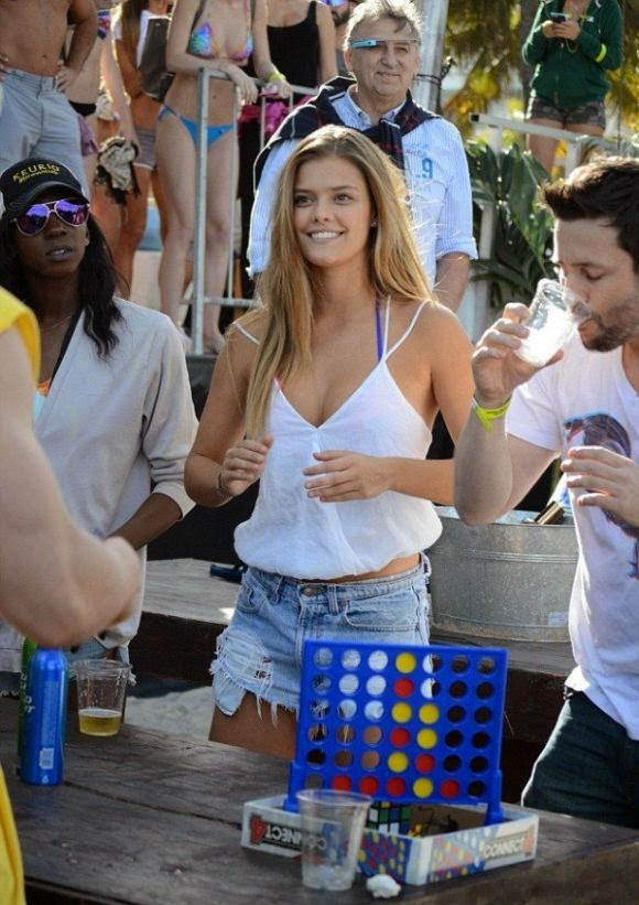 Nina Agdal wears a daisy duke during her job at the Model Beach Volleyball Tournament in Miami, FL, USA on Saturday, February 7, 2015