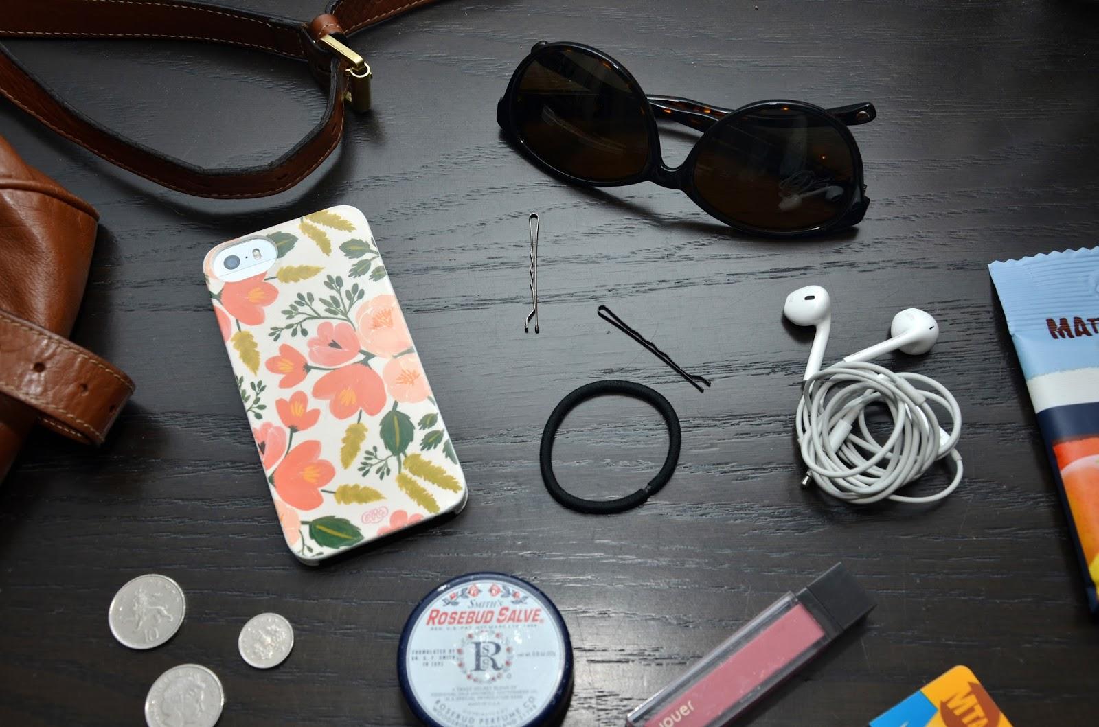 handbag essentials with rue la la