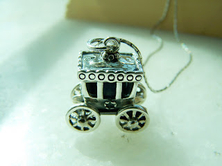 silver pendant,carriage,jewelry,sculpture