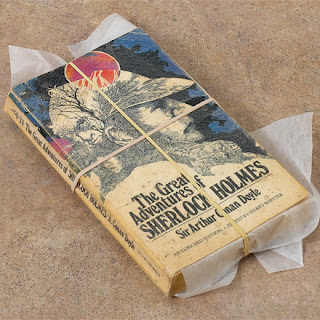 Mass market paperback book in stage of book repair