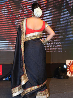 Charmi Hot Dancing Photos at Jyothi Lakshmi Audio Launch Event