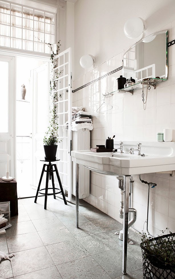 Black and white bathroom with square tiles and a French door