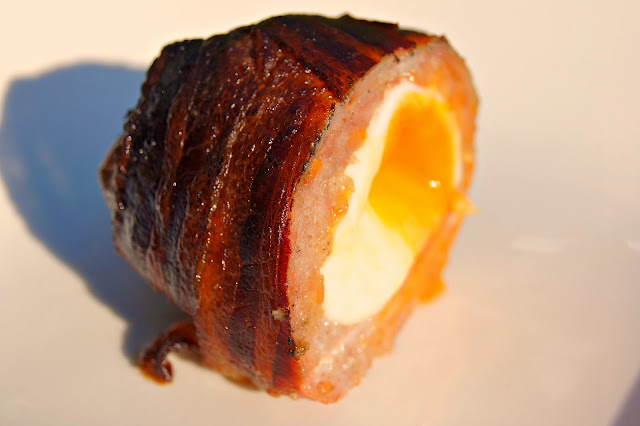 Scotch eggs bacon wrapped and plank smoked