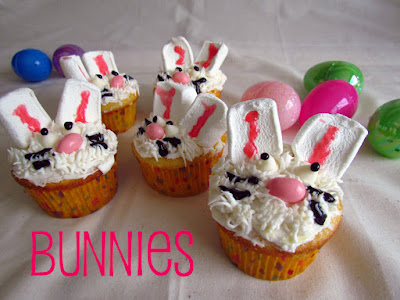 easter bunny cupcakes with white frosting and jelly bean noses and marshmallow ears