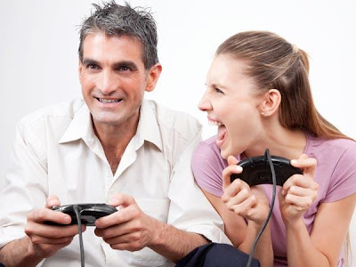 How To Be A Challenge For Your Man - man and woman playing video games