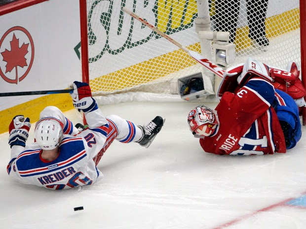 Carey Price is injured by Rangers Chris Kreider