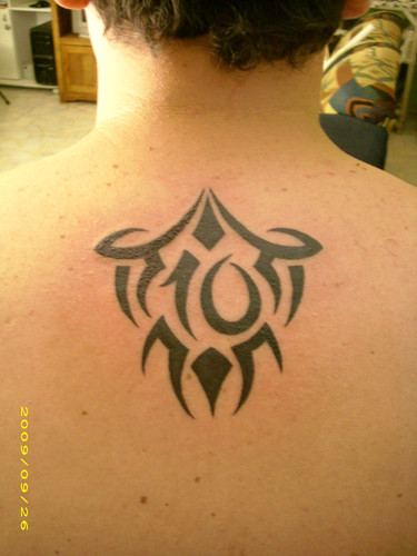 Men tribal tattoos Tribal tattoos for men Upper back tribal tattoos