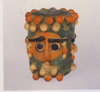 Head bead, 400-200 B.C. Length, 3.4 cm