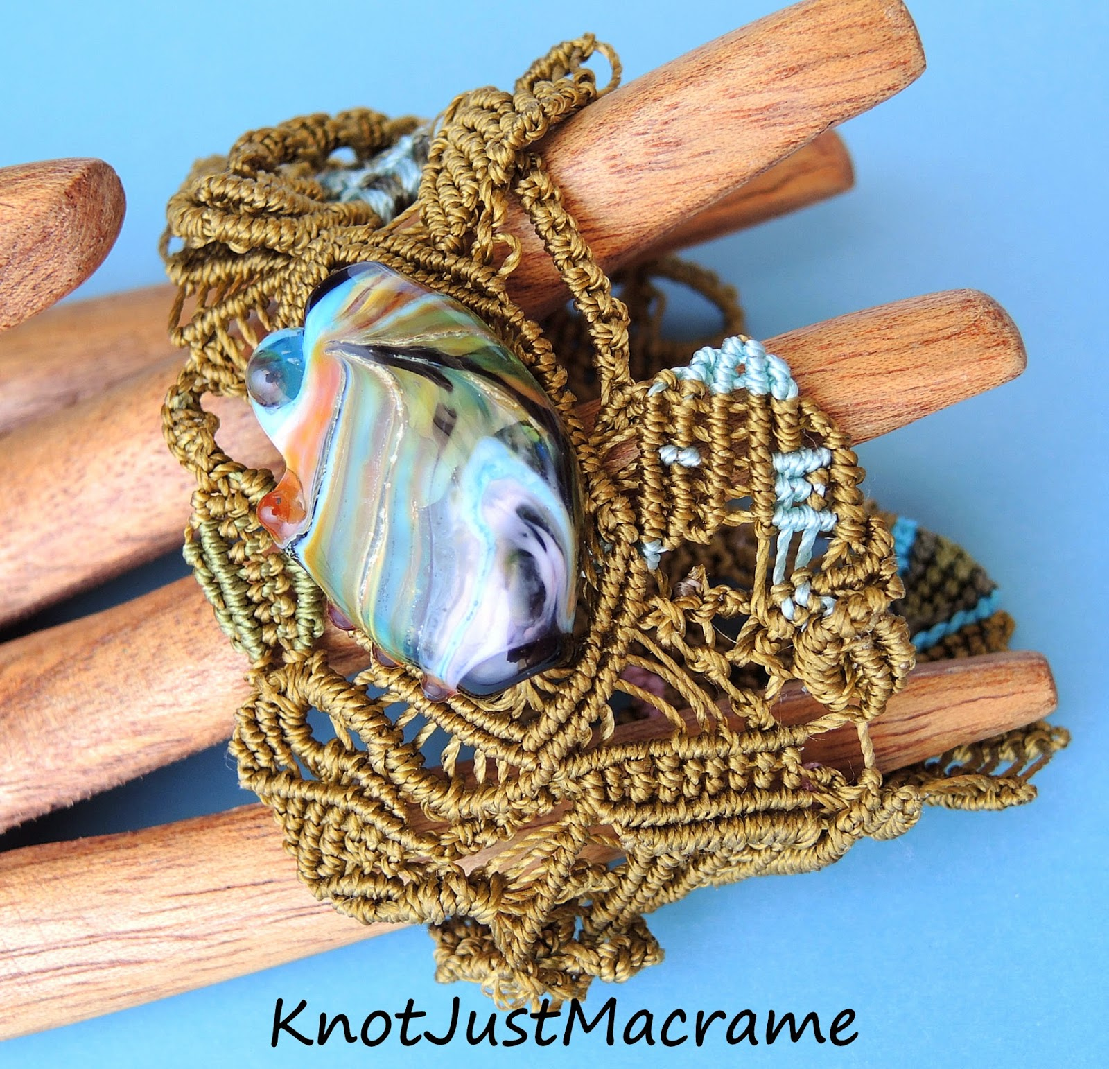 Free form micro macrame bracelet by Knot Just Macrame with lamp work focal by Laurie Ament.