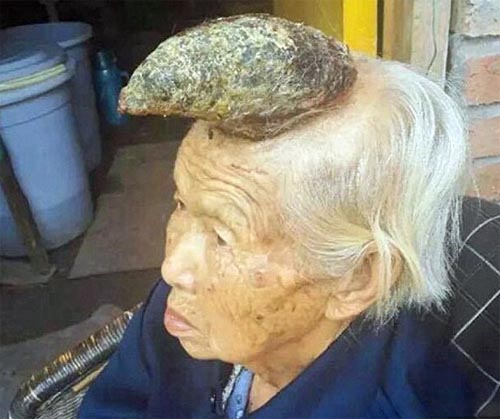 Old woman with horn