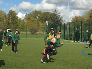 tag rugby player running with ball