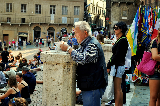 Gentleman in the Crowd on the Piazza del Campo in Siena, Italy | Taste As You Go