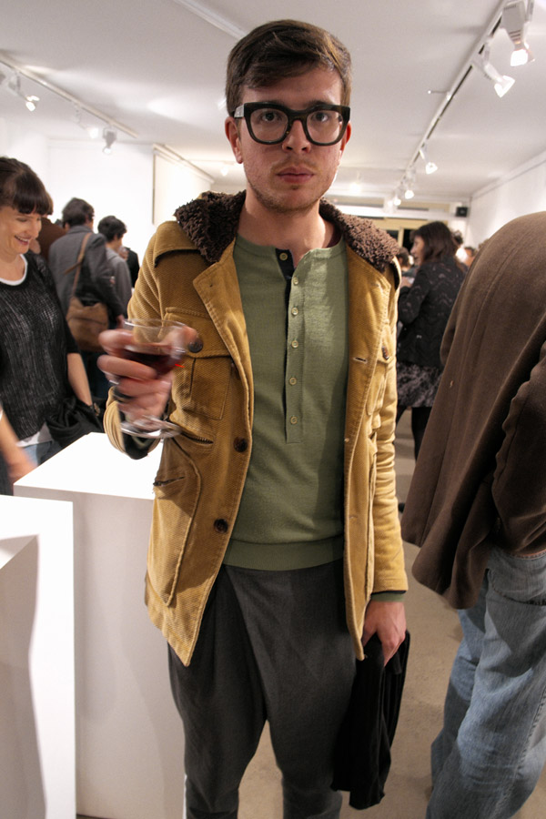 Mens grey wrap pants, cord jacket, green long button knit, heavy black glasses shirt, at opening, Street Fashion Sydney