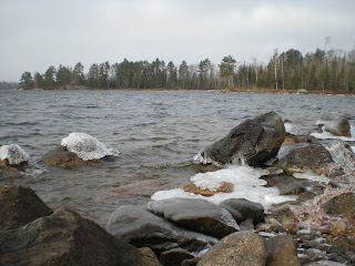 Icy capped rocks on shore http://huismanconcepts.com/