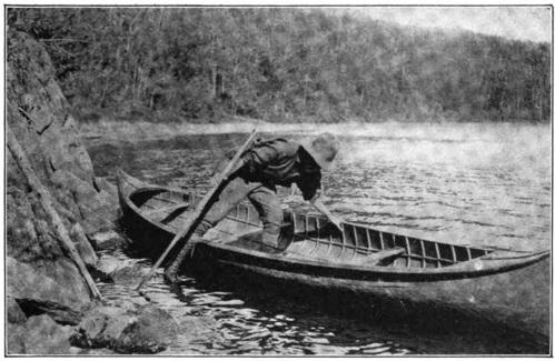 Kathrene Pinkerton getting into her canoe