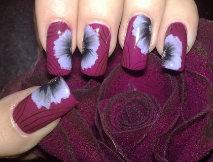 Purple Nail Art with White Flowers