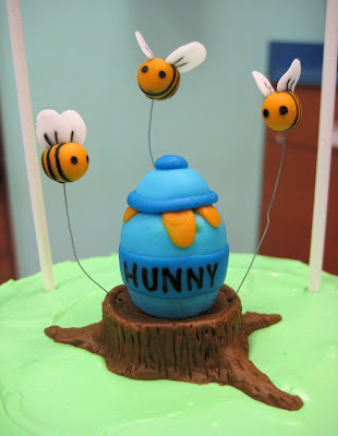 Winnie the Pooh Marching Band Cake - Close-Up of Bees, Honey Pot, and Tree Stump