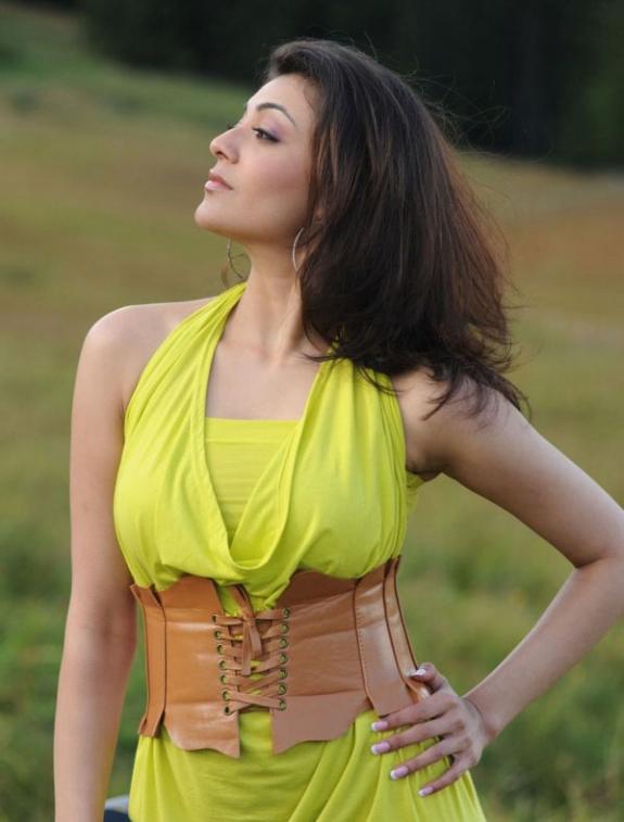 Spicy Kajal Agarwal In Hot Mood Yellow Dress Latest Stills Photos navel show