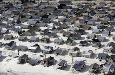 Sand now covers homes and streets along the Jersey Shore after Hurricane Sandy