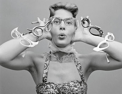 A model with the latest styles of spectacles, 1956. Copyright: Getty Images