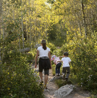 Walking in the backlit aspen woods with family in Grand Teton National PArk