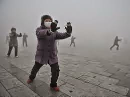 Chinese doing exercise wearing masks in Beijing