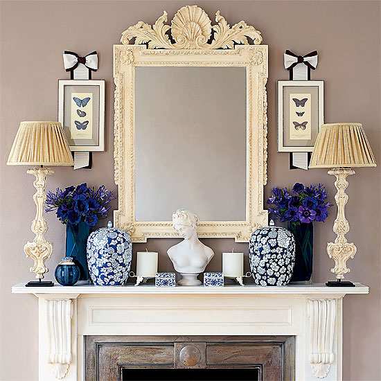 a lovely parisian style mantel decorated in baroque style the symmetry in delftware is soothing and the colors have a subtle elegance