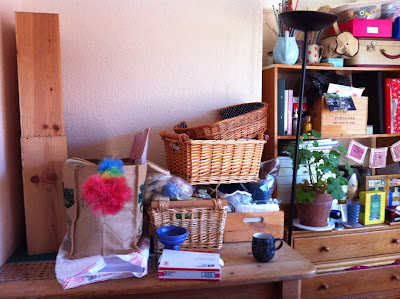 Baskets and boxes of studio supplies being sorted