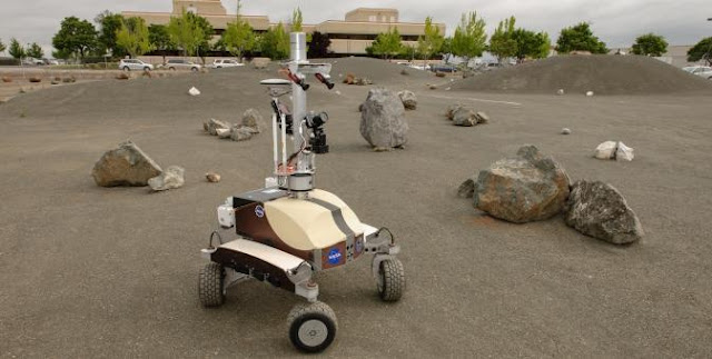 K10 Black planetary rover navigates the boulder field in the Roverscape during a Surface Telerobotics Operational Readiness Test at NASA's Ames Research Center. Image Credit: NASA/Dominic Hart