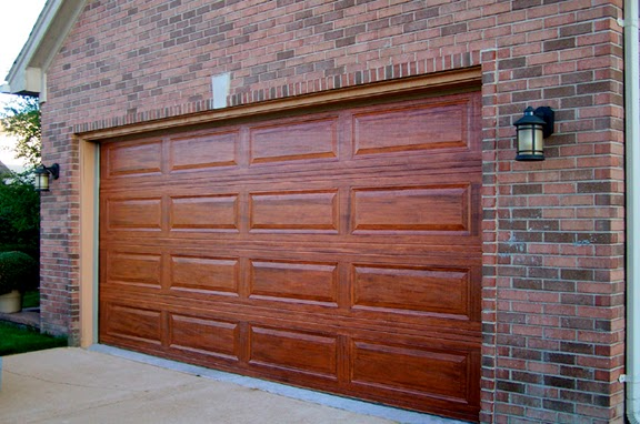 Garage door journal how to paint your boring metal garage for Paint garage door to look like wood