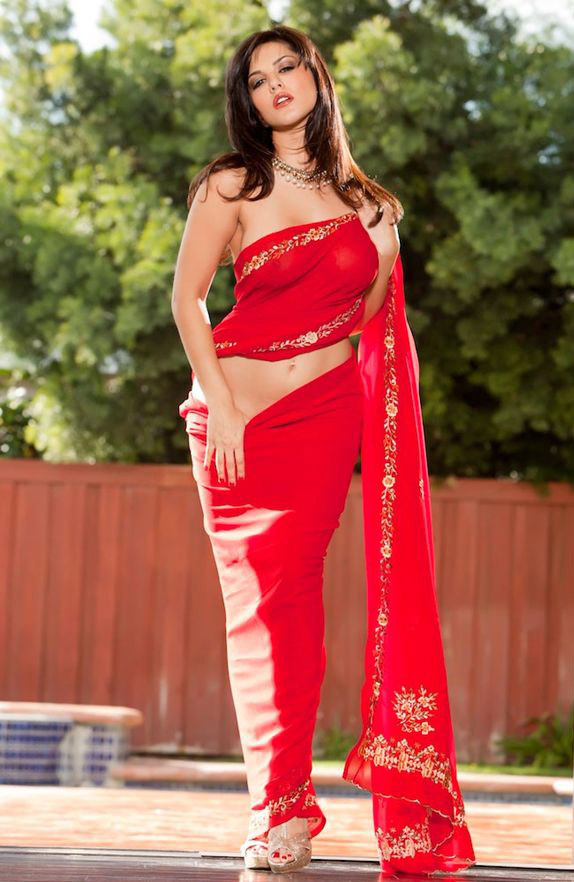 There is not much we can say about this hottie, Sunny Leone. Sunny Leone can look hot in any red, but a red dress just makes her more sensual and an eye feast.
